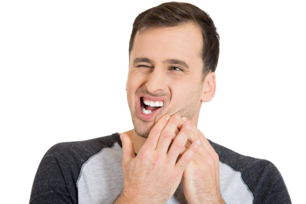 Image of individual holding jaw